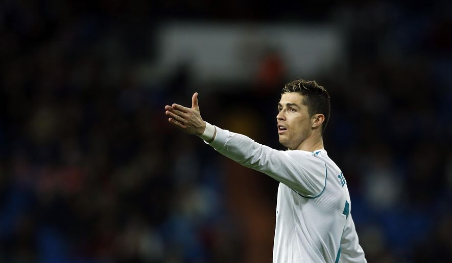 Real Madrid's Cristiano Ronaldo gestures during the Spanish La Liga soccer match between Real Madrid and Getafe at the Santiago Bernabeu stadium in Madrid, Saturday, March 3, 2018. Ronaldo scored twice in Real Madrid's 3-1 victory. (AP Photo/Francisco Seco)