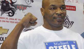 FILE - In a Thursday, Oct. 19, 2006 file photo, former heavyweight champion Mike Tyson pumps his fist in the air during his weigh-in at the Chevrolet Centre in Youngstown, Ohio. Living Word Sanctuary Church is converting a Southington Township, Ohio mansion once owned by Tyson into a house of worship. (AP Photo/Mark A. Stahl, File)
