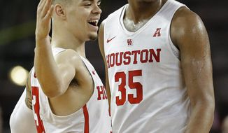 Houston forward Fabian White Jr. (35) and guard Rob Gray celebrate in the final seconds of an NCAA college basketball game against Connecticut, Sunday, March 4, 2018, in Houston. (AP Photo/Eric Christian Smith)