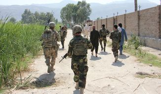 Afghan National Army troops from 201st Corps and 3rd Brigade Combat Team, 101st Airborne Division (AASLT) soldiers assigned to Train Advise Assist Command-East enter a village during a partnered force protection patrol in Laghman province Sept. 23, 2015. (U.S. Army photo by Capt. Jarrod Morris)