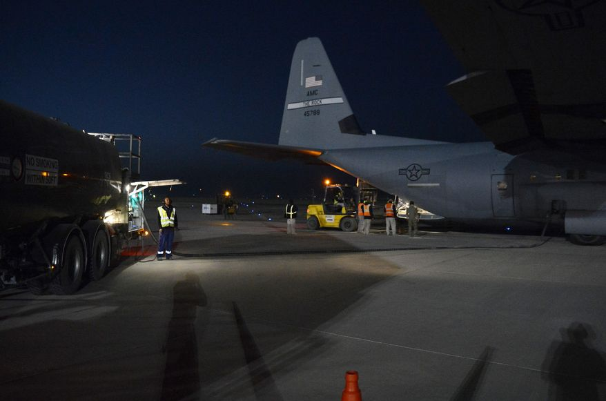 A C-130J Super Hercules from the 774th Expeditionary Airlift Squadron receives fuel from a fuel truck during a wet-wing mission Dec. 10, 2017 at Kandahar Airfield, Afghanistan. The C-130J then flew to a forward operating base where it completed the wet-wing mission by delivering excess fuel to the user. A wet-wing defuel is traditionally a special operations forces mission, but by training mobility air force C-130J crews in this capability as well as hot refueling, conventional forces augment limited SOF resources. (U.S. Air Force photo/Staff Sgt. Divine Cox) ** FILE **