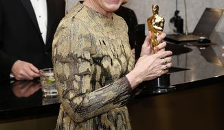 """Frances McDormand, winner of the award for best performance by an actress in a leading role for """"Three Billboards Outside Ebbing, Missouri"""", attends the Governors Ball after the Oscars on Sunday, March 4, 2018, at the Dolby Theatre in Los Angeles. (Photo by Eric Jamison/Invision/AP)"""