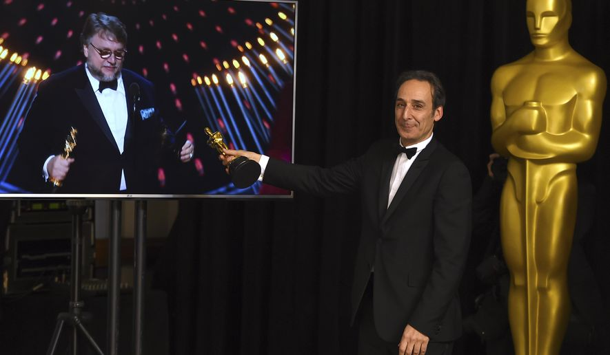 "Alexandre Desplat, winner of the award for best original score for ""The Shape of Water"", poses in the press room as Guillermo del Toro wins the award for best director for ""The Shape of Water"" at the Oscars on Sunday, March 4, 2018, at the Dolby Theatre in Los Angeles. (Photo by Jordan Strauss/Invision/AP)"