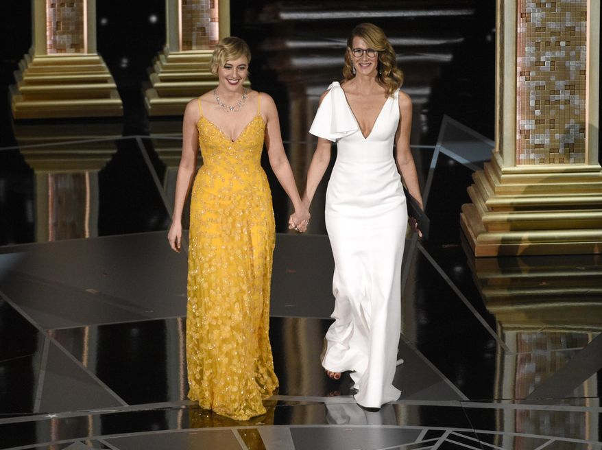 Greta Gerwig, left, and Laura Dern walk on stage to present the award for best documentary feature at the Oscars on Sunday, March 4, 2018, at the Dolby Theatre in Los Angeles. (Photo by Chris Pizzello/Invision/AP)