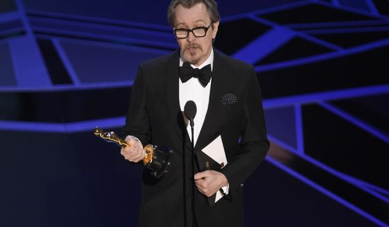 "Gary Oldman accepts the award for best performance by an actor in a leading role for ""Darkest Hour"" at the Oscars on Sunday, March 4, 2018, at the Dolby Theatre in Los Angeles. (Photo by Chris Pizzello/Invision/AP)"