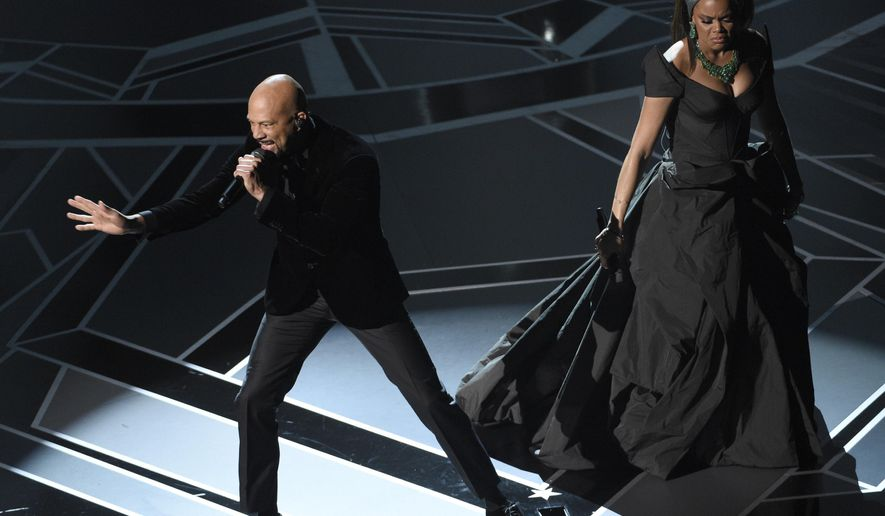 "Common, left, and Andra Day perform ""Stand Up For Something"" from the film ""Marshall"" at the Oscars on Sunday, March 4, 2018, at the Dolby Theatre in Los Angeles. (Photo by Chris Pizzello/Invision/AP)"
