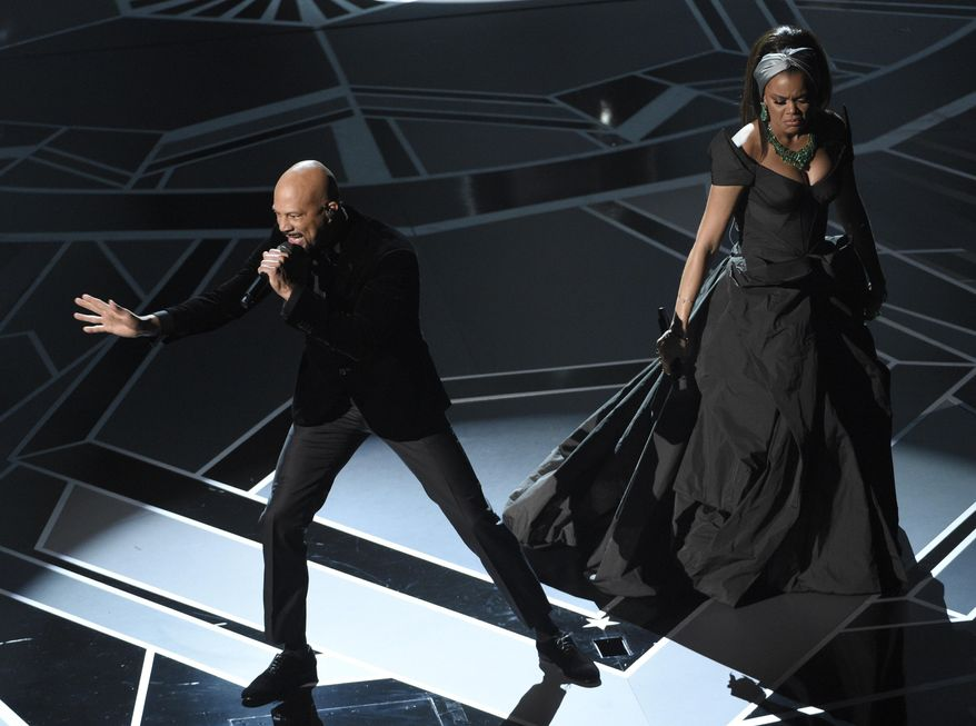 """Common, left, and Andra Day perform """"Stand Up For Something"""" from the film """"Marshall"""" at the Oscars on Sunday, March 4, 2018, at the Dolby Theatre in Los Angeles. (Photo by Chris Pizzello/Invision/AP)"""