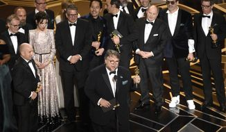 """Guillermo del Toro and the cast and crew of """"The Shape of Water"""" accept the award for best picture at the Oscars on Sunday, March 4, 2018, at the Dolby Theatre in Los Angeles. (Photo by Chris Pizzello/Invision/AP)"""