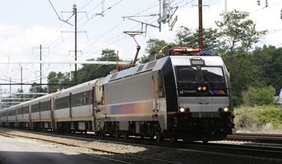 A New Jersey Transit train passes through Princeton Junction, Tuesday, July 18, 2017, in West Windsor Township, N.J. (AP Photo/Kathy Willens)