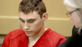 Nikolas Cruz, accused of murdering 17 people in the Florida high school shooting, appears in court for a status hearing in Fort Lauderdale, Fla. Cruz reportedly had a history of shooting small animals. While some animal welfare advocates question the usefulness of animal abuser registries, laws creating them have been passed in a growing number of municipalities in recent years with proponents citing studies linking animal cruelty to crimes ranging from domestic violence to mass shootings. (Mike Stocker/South Florida Sun-Sentinel via AP, Pool, File)