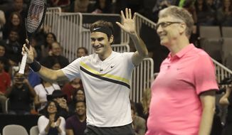 Roger Federer, of Switzerland, left, smiles as he and partner Bill Gates play in an exhibition tennis match against Jack Sock and Savannah Guthrie in San Jose, Calif., Monday, March 5, 2018. (AP Photo/Jeff Chiu) ** FILE **