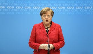 German Chancellor and chairwomen of the German Christian Democratic Union (CDU), Angela Merkel, addresses the media during a statement at the party headquarters in Berlin, Germany, Monday, March 5, 2018. (AP Photo/Michael Sohn)