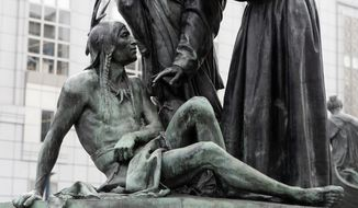 A statue of a Native American below Sir Francis Drake and Father Junipero Serra in San Francisco. San Francisco's arts commission is considering removing a statue that some say is degrading to Native Americans. The city's arts commission is scheduled to discuss the sculpture Monday and has the final say on its fate. (AP Photo/Jeff Chiu)