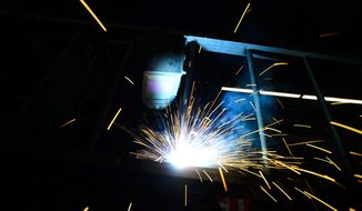A welder fabricates a steel structure at an iron works facility in Ottawa, Ontario, Monday, March 5, 2018. United States President Donald Trump has lobbed a grenade of uncertainty onto the NAFTA negotiating table, suggesting that tariffs on Canadian and Mexican steel are now dependent on whether the countries agree to a new trade pact. (Sean Kilpatrick/The Canadian Press via AP)