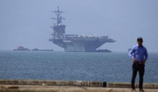 USS Carl Vinson is anchored at Tien Sa Port in Danang, Vietnam, Monday, March 5, 2018. For the first time since the Vietnam War, the U.S. Navy aircraft carrier is paying a visit to a Vietnamese port, seeking to bolster both countries' efforts to stem expansionism by China in the South China Sea. (AP Photo/Tran Van Minh)