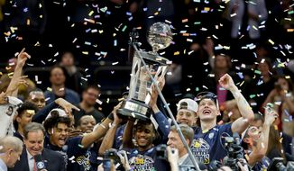 Michigan players celebrate after beating Purdue 75-66 to win the NCAA Big Ten Conference tournament championship college basketball game, Sunday, March 4, 2018, in New York. (AP Photo/Julie Jacobson)