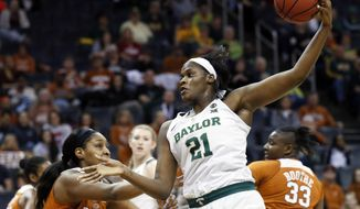 Baylor center Kalani Brown (21) grabs an inbound pass in front of Texas forward Jatarie White (40) in the first half of an NCAA college basketball game in the championship game of the women's Big 12 conference tournament in Oklahoma City, Monday, March 5, 2018. (AP Photo/Sue Ogrocki)