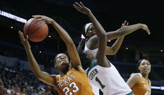 Texas guard Ariel Atkins (23) grabs a rebound in front of Baylor center Kalani Brown, top, and forward Dekeiya Cohen (1) in the first half of an NCAA college basketball game in the championship game of the women's Big 12 conference tournament in Oklahoma City, Monday, March 5, 2018. (AP Photo/Sue Ogrocki) ** FILE **