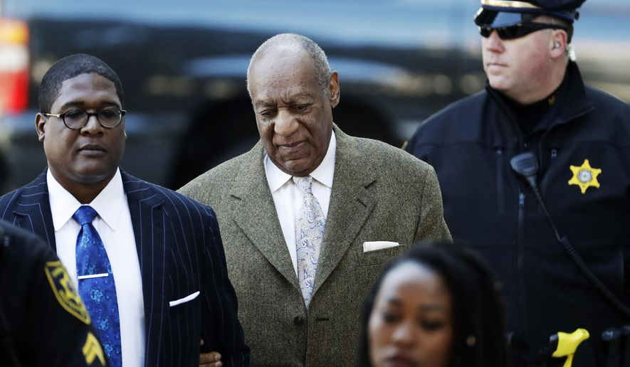 Bill Cosby, center, arrives for a pretrial hearing in his sexual assault case at the Montgomery County Courthouse, Monday, March 5, 2018, in Norristown, Pa. (AP Photo/Matt Slocum)