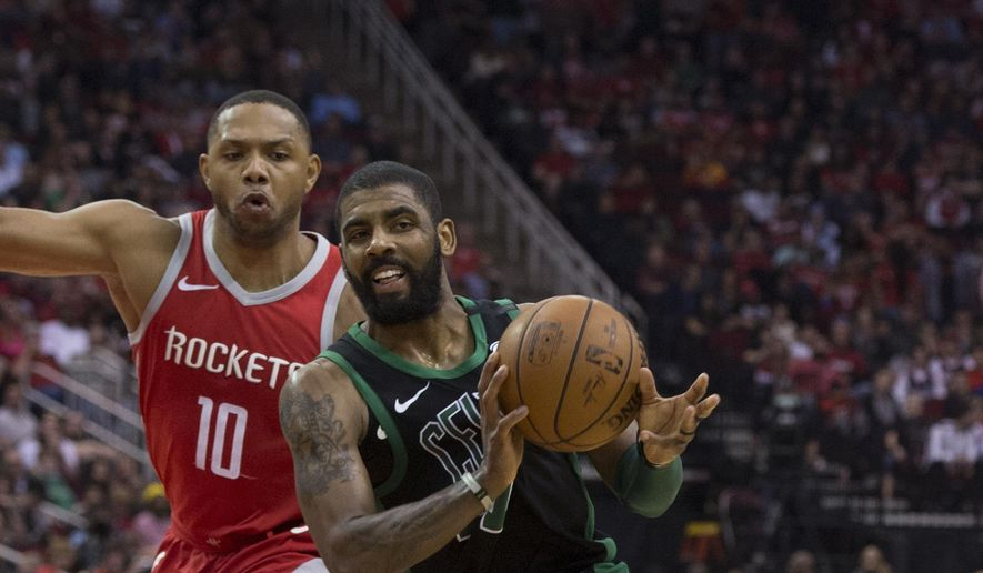 Boston Celtics guard Kyrie Irving (11) passes the ball as he drives against Houston Rockets guard Eric Gordon (10) during the second half of an NBA basketball game Saturday, March 3, 2018, in Houston. (AP Photo/George Bridges) **FILE**