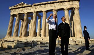 Greek Prime minister George Papandreou, left, and his Chinese counterpart Wen Jiabao pose for a picture in front of the ancient Parthenon temple at the Acropolis hill in Athens, Sunday, Oct. 3, 2010. Wen vowed Saturday to double trade with Greece within five years, and to buy Greek bonds when the crisis-hit country returns to international markets. (AP Photo/Petros Giannakouris)