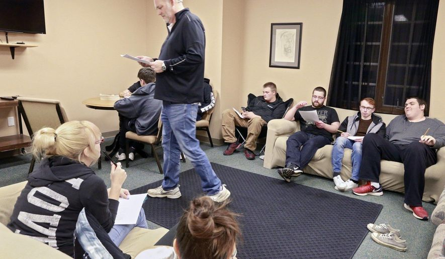 In this Feb. 28, 2018, photo, the Rev. Dan Brown leads a senior youth group in discussion at First Baptist Church of Sunbury, Ohio. (Barbara J. Perenic/The Columbus Dispatch via AP)