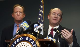 U.S, Sen. Chris Coons, D-Del., right, speaks alongside U. S. Sen. Pat Toomey, R-Pa., during a press conference, Monday, March 5, 2018, in Philadelphia. Toomey and Coons say they'll introduce a bill Monday that will require federal authorities to notify states when a felon or a fugitive attempts to buy a firearm but fails the National Instant Criminal Background Check System. (AP Photo/Jacqueline Larma)