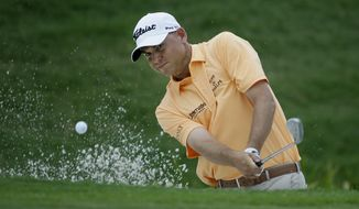 FILE - In this May 28, 2017, file photo, Bill Haas hits from the sand during the final round of the Dean & DeLuca Invitational golf tournament at Colonial Country Club in Fort Worth, Texas. Haas returns to golf this week knowing the Valspar Championship will be unlike any of the previous 347 times he has played on the PGA Tour. He is playing for the first time since he was the passenger in a car accident that killed the driver in Los Angeles. (AP Photo/LM Otero, File)