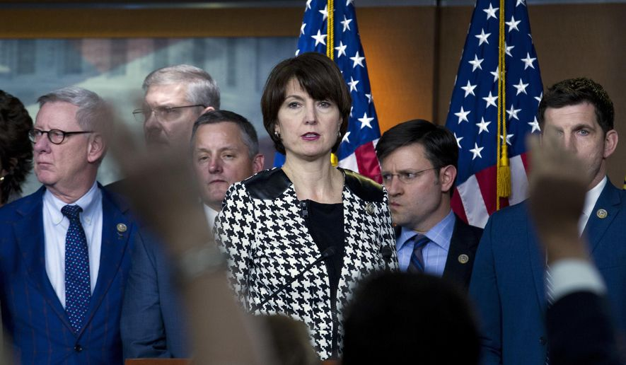 FILE - In this Jan. 20, 2018, file photo, Rep. Cathy McMorris Rodgers, R-Wash., accompanied by other members of the congress, speaks during a news conference at Capitol Hill in Washington. McMorris Rodgers has steadily risen in leadership roles in the U.S. House while easily winning seven elections in conservative eastern Washington state. But facing a serious challenge from a popular Democrat, the GOP is pouring money and resources this year into a 5th Congressional District contest the party had been able to ignore for 20 years. (AP Photo/Jose Luis Magana, File)