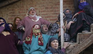 Kashmiri village women react as they watch from a distance the funeral of civilian Suhail Ahmad at Pinjura village 52 kilometers (33 miles) south of Srinagar, Indian controlled Kashmir, Monday, March 5, 2018. More than a dozen protests erupted across Kashmir on Monday, with government forces firing tear gas and demonstrators hurling rocks as tens of thousands of protesters poured into the streets of the disputed Himalayan region after soldiers killed four civilians and two suspected militants. (AP Photo/Mukhtar Khan)