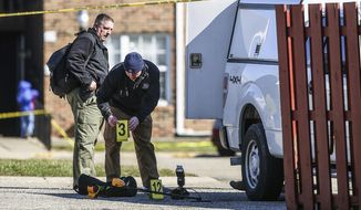 Police investigate the scene of a shooting, Friday, March 2, 2018 in Lebanon, Ind, Jacob Pickett, a central Indiana sheriff's deputy who was shot in the head while chasing three suspects won't survive and was on life support for donation of his organs, authorities said Friday. (Jenna Watson/The Indianapolis Star via AP)