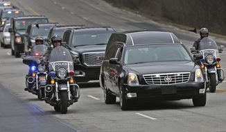 """IMPD, Sheriff, and State Police officers travel on Meridian St. in Indianapolis as they escort the body of Boone Co. sheriff's deputy Jacob """"Jake"""" Pickett from St. Vincent's Hospital downtown to the Marion County Coroner's office, Monday, Mar. 5, 2018. The officer, who was helping Lebanon police officers serve a warrant Friday, Mar. 2, 2018, was fatally wounded. He was taken off life support earlier this morning.  (Kelly Wilkinson/The Indianapolis Star via AP)"""