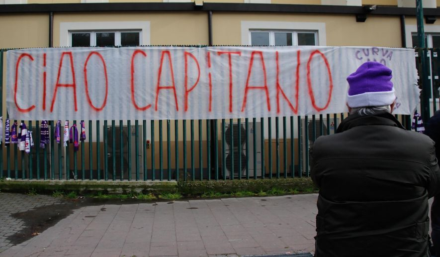 """A banner reading in Italian """"So long captain"""" is hung outside the Artemio Franchi stadium to honor Fiorentina captain Davide Astori, in Florence, Italy, Sunday, March 4, 2018. Fiorentina captain Davide Astori has died, the club has announced Sunday. He was 31. Astori was found in the early hours of Sunday morning in his hotel room in Udine, where the team was staying ahead of an Italian league match. (Maurizio Degl'Innocenti/ANSA via AP)"""