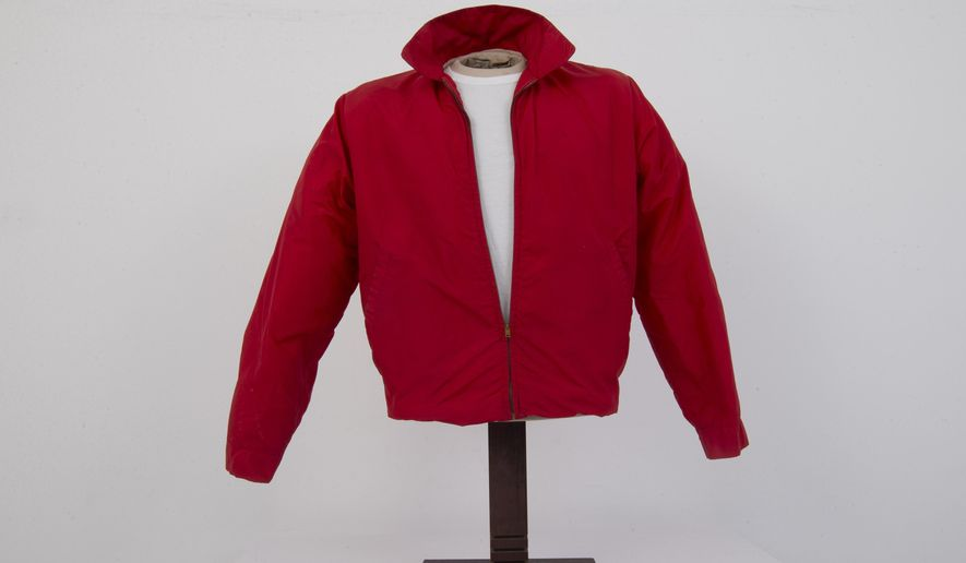 """In this, Monday, Feb. 12, 2018, photo, a jacket worn by actor James Dean in the film """"Rebel Without a Cause,"""" is displayed at Palm Beach Modern Auctions in West Palm Beach, Fla. The jacket, privately owned since Dean wore it in the 1955 film, will be publicly auctioned in Florida on March 3. (AP Photo/Wilfredo Lee)"""