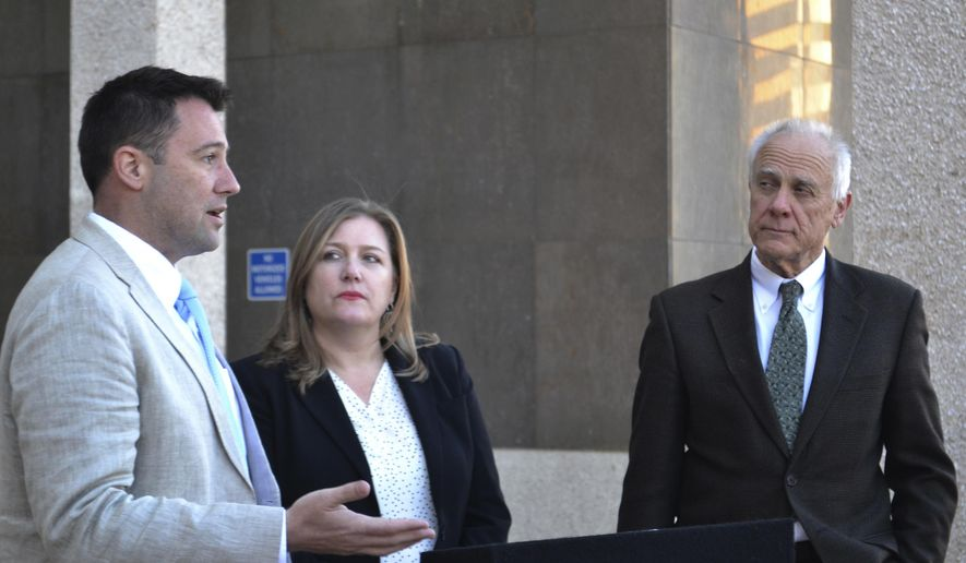 Albuquerque City Councilor Pat Davis, left, discusses a proposal to decriminalize possessing an ounce of marijuana or less with Emily Kaltenbach, of the Drug Policy Alliance, center, and fellow Councilman Isaac Benton, right, at a news conference in Albuquerque, N.M., Monday, March 5, 2018. Davis and Benton's proposed change to the local criminal code would add Albuquerque to a growing list of municipalities that have decriminalized possessing pot in small amounts. (AP Photo/Mary Hudetz).
