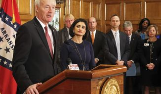Gov. Asa Hutchinson speaks at a news conference Monday, March 5, 2018, at the state Capitol in Little Rock, Ark., with Seema Verma, the head of the Centers for Medicare and Medicaid Services. Verma on Monday approved a state plan to require that thousands of people on its Medicaid expansion seek ways to work or volunteer. Traditional Medicaid recipients are not affected. Arkansas is the third state to win permission, following Kentucky and Indiana. (AP Photo/Kelly P. Kissel)