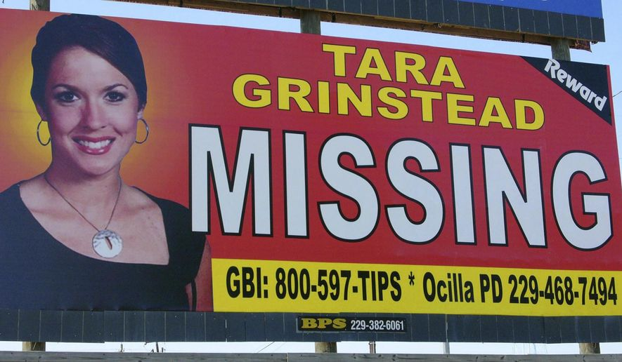 FILE - In this Oct. 4, 2006, file photo, teacher Tara Grinstead is displayed on a billboard in Ocilla, Ga. Grinstead disappeared in 2005 and her case was cold for more than a decade before authorities announced an arrest in February 2017. A judge issued a gag order in the case, but the Georgia Supreme Court threw it out on Monday, March 5, 2018, saying it wasn't warranted. (AP Photo/Elliott Minor, File)