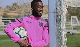 In this photo taken on Thursday Feb. 22, 2018, Shaq Moore poses before training with Spanish soccer club Levante in Valencia, Spain. Young American soccer player Shaq Moore is trying to make it in Europe the hard way, going to the old continent as a teenager to join smaller teams and try to move up in his career like other European youngsters. Currently with the first team of Levante, he now he is having a chance to play against Lionel Messi and Cristiano Ronaldo in La Liga. (AP Photo/Tales Azzoni)