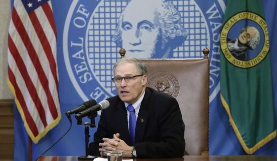Washington Gov. Jay Inslee speaks after signing a bill Monday, March 5, 2018, in Olympia, Wash., that makes Washington the first state to set up its own net-neutrality requirements in response to the Federal Communications Commission's recent repeal of Obama-era rules. The FCC voted in December to gut U.S. rules that meant to prevent broadband companies such as Comcast, AT&T and Verizon from exercising more control over what people watch and see on the internet. (AP Photo/Ted S. Warren) ** FILE **