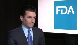 Food and Drug Administration Commissioner Scott Gottlieb listens during an interview with The Associated Press in New York on Monday, March 5, 2018. Gottlieb said Monday that he needs more staffers to intercept opioids that are being disguised as other drugs and supplements. (AP Photo/Kathy Young)