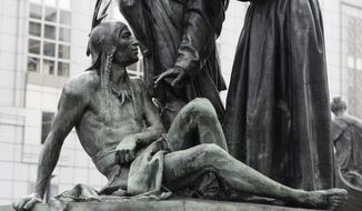 This Friday, March 2, 2018 photo shows a statue of a Native American below Sir Francis Drake and Father Junipero Serra in San Francisco. San Francisco's arts commission is considering removing a statue that some say is degrading to Native Americans. The city's arts commission is scheduled to discuss the sculpture Monday and has the final say on its fate. (AP Photo/Jeff Chiu)