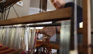 In this March 2, 2018, photo, Christine Sheppard works with her loom in her home in Oceanside, Calif. Claims that the active ingredient in the widely used weed killer Roundup can cause cancer have been evaluated by international agencies, U.S. and foreign regulators and the product's manufacturer, agribusiness giant Monsanto. Sheppard, among those suing Monsanto, said she sprayed Roundup for years to control weeds on her Hawaii coffee farm. (AP Photo/Gregory Bull)