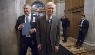 FILE - In this Jan. 10, 2018, file photo Sen. Thad Cochran, R-Miss., returns to the Capitol for a vote in Washington.  Cochran tells The Associated Press he will resign April 1 because of health problems. The 80-year-old has had Cochran stayed home for a month last fall with urinary tract infections, returning to Washington in October to give Republicans the majority they needed to pass a budget plan. (AP Photo/J. Scott Applewhite, File)