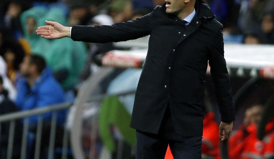 Real Madrid head coach Zinedine Zidane gives instructions from the side line during the Spanish La Liga soccer match between Real Madrid and Getafe at the Santiago Bernabeu stadium in Madrid, Saturday, March 3, 2018. Real Madrid won 3-1. (AP Photo/Francisco Seco)