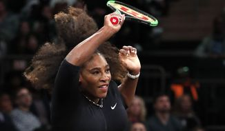 Serena Williams of the United States swings through on a return to Marion Bartoli during the Tie Break Tens tournament at Madison Square Garden, Monday, March 5, 2018 in New York. The Tie Break Tens' New York event is a one-day day exhibition tournament featuring eight female players competing for a $250,000 winner's prize. (AP Photo/Kathy Willens)