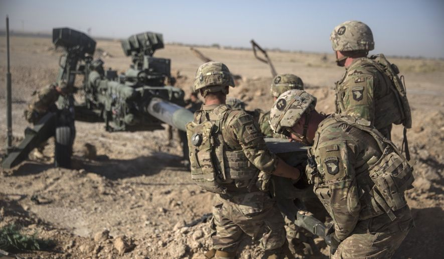 This June 10, 2017 photo provided by Operation Resolute Support, U.S. Soldiers with Task Force Iron maneuver an M-777 howitzer, so it can be towed into position at Bost Airfield, Afghanistan. (U.S. Marine Corps photo by Sgt. Justin T. Updegraff, Operation Resolute Support via AP)