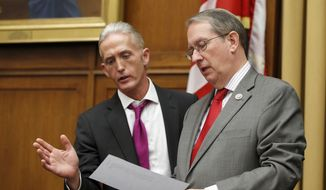 Rep. Trey Gowdy, R-S.C., left, speaks with Judiciary Committee Chairman Bob Goodlatte, of Virginia during a break in a hearing with Attorney General Jeff Sessions, on Capitol Hill, Tuesday, Nov. 14, 2017 in Washington. (AP Photo/Alex Brandon) ** FILE **
