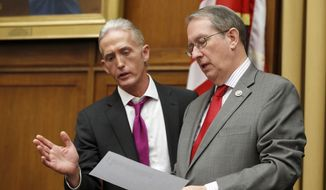 Rep. Trey Gowdy, R-S.C., left, speaks with Judiciary Committee Chairman Bob Goodlatte, of Virginia during a break in a hearing with Attorney General Jeff Sessions, on Capitol Hill, Tuesday, Nov. 14, 2017 in Washington. (AP Photo/Alex Brandon)