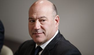 White House chief economic adviser Gary Cohn listens during a meeting between President Donald Trump and Israeli Prime Minister Benjamin Netanyahu at the World Economic Forum, Thursday, Jan. 25, 2018, in Davos. (AP Photo/Evan Vucci)