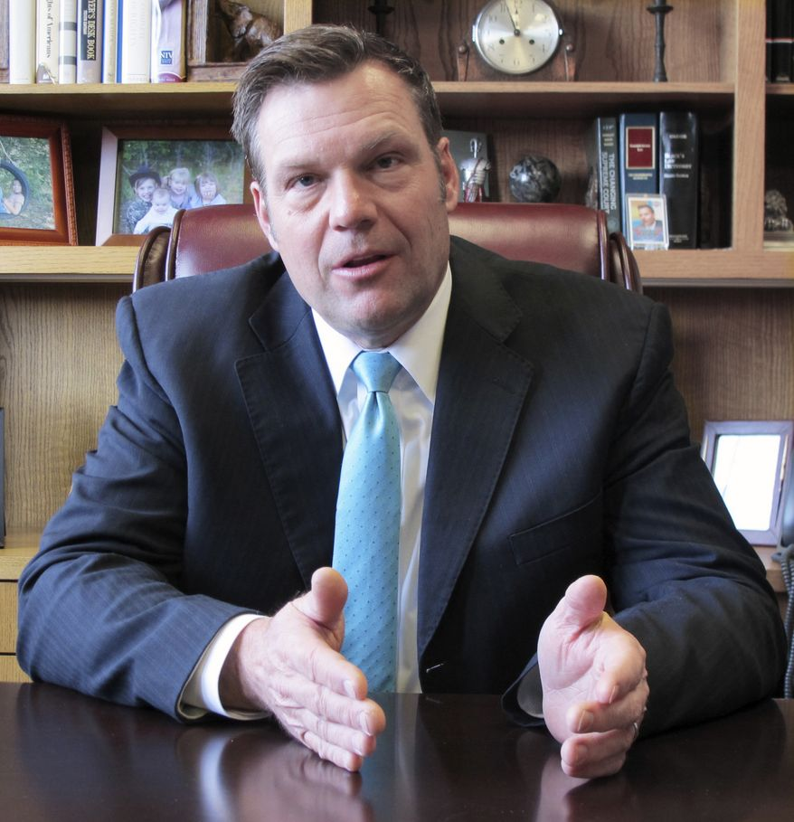 FILE - In this Jan. 4, 2018 photo, Kansas Secretary of State Kris Kobach speaks during an interview in Topeka, Kan. Legal challenges to a Kansas law requiring proof of citizenship to register to vote, will go on trial next week in a case with national implications for voting rights. At issue in a trial that begins Tuesday, March 6, 2018. is the fate of a Kansas law championed by Kansas Secretary of State Kobach. That law requires people to provide citizenship documents such as a birth certificate, naturalization papers or passport at the time they register to vote.(AP Photo/John Hanna)